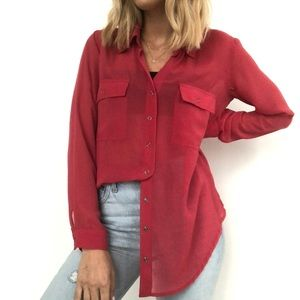 red sheer blouse